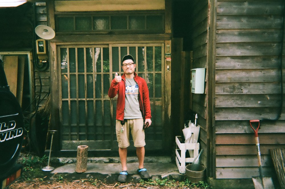 Yusuke-san, owner of Koya Backpackers, striking a pose for my camera before he packed me off and sent me on my way to the train station   It made me laugh when I saw this photo, partly because I forgot that I took it. Also because I could almost hear Yusuke-san's jugdmental remarks about my huge four wheeled luggage bag.