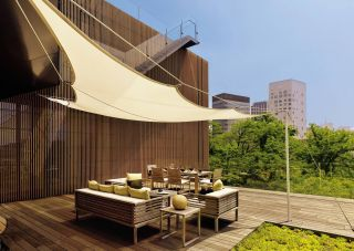 CONTEMPORARY OUTDOOR SPACE BY MLINARIC, HENRY & ZERVUDACHI  A terrace on the fourth floor of a home in Japan is shaded by a canopy.   ARCHITECT:   Kengo Kuma & Associates    DESIGNER:   Mlinaric, Henry & Zervudachi    PHOTOGRAPHER:   Robert McLeod    ARTICLE:   Asian Fusion,   October 2010    LOCATION:   Japan
