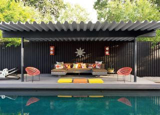 MODERN OUTDOOR SPACE BY JONATHAN ADLER  In the pool pavilion of Jonathan Adler and Simon Doonan's Shelter Island, New York, retreat, the throw pillows and sun wall sculpture are by Adler; the cushions are clad in Sunbrella fabrics, and the sconces are vintage.   ARCHITECT:   Gray Organschi Architecture    DESIGNER:   Jonathan Adler    PHOTOGRAPHER:   Joshua McHugh    HOMEOWNER:   Jonathan Adler and Simon Doonan    ARTICLE:   True To Form,   July 2012    LOCATION:   Shelter Island, New York