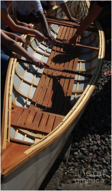 A boat and the hands that built it at Pines school in 2012.