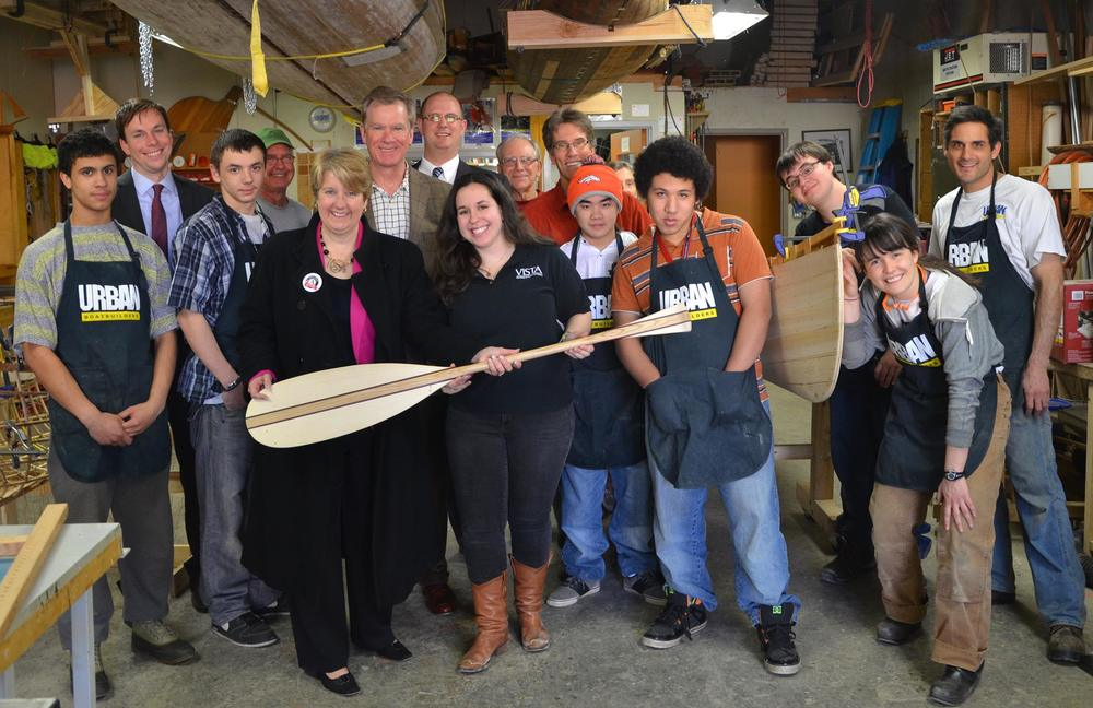 Because of the exemplary work done by our AmeriCorps VISTA Sara, Mayor Chris Coleman and CEO for the Corporation of National and Community Service Wendy Spencer visited the Urban Boatbuilders shop! After a shop tour by Sara and the Apprentices, everyone sat down to discuss all the great things happening at Urban Boatbuilders.  Wendy Spencer was so excited about the work we are doing that she mentioned Urban Boatbuilders in a speech she gave at the Presidio Institute in San Francisco. A successful visit!