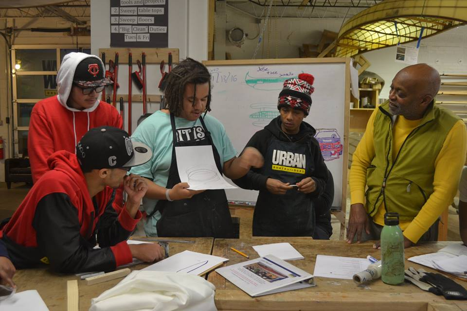 Seitu Jones (right) and Apprentices working on initial designs.