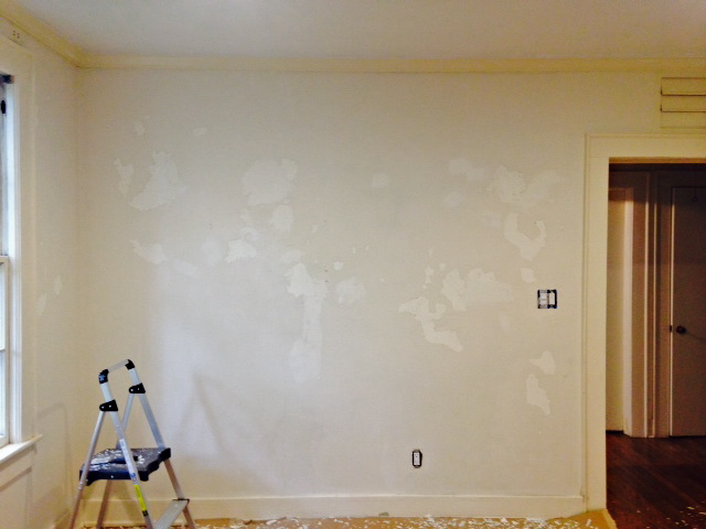 LIVING ROOM (NORTH WALL):  LOOSE PAINT SCRAPED IN PREPARATION FOR SPACKLING AND PAINTING.  MANY OTHER WALLS WERE SIMILAR TO THIS.