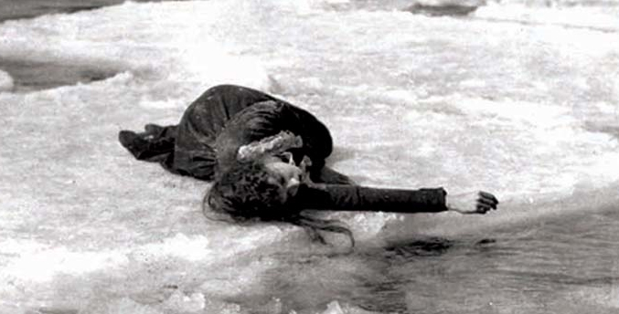 Lilian Gish lays on ice.