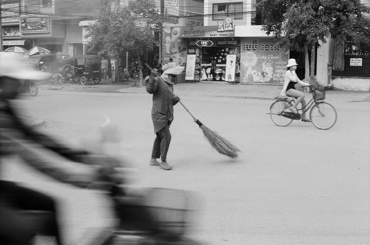 Basil Glew-Galloway, Cambodia trip pictures. Sweeping the street.
