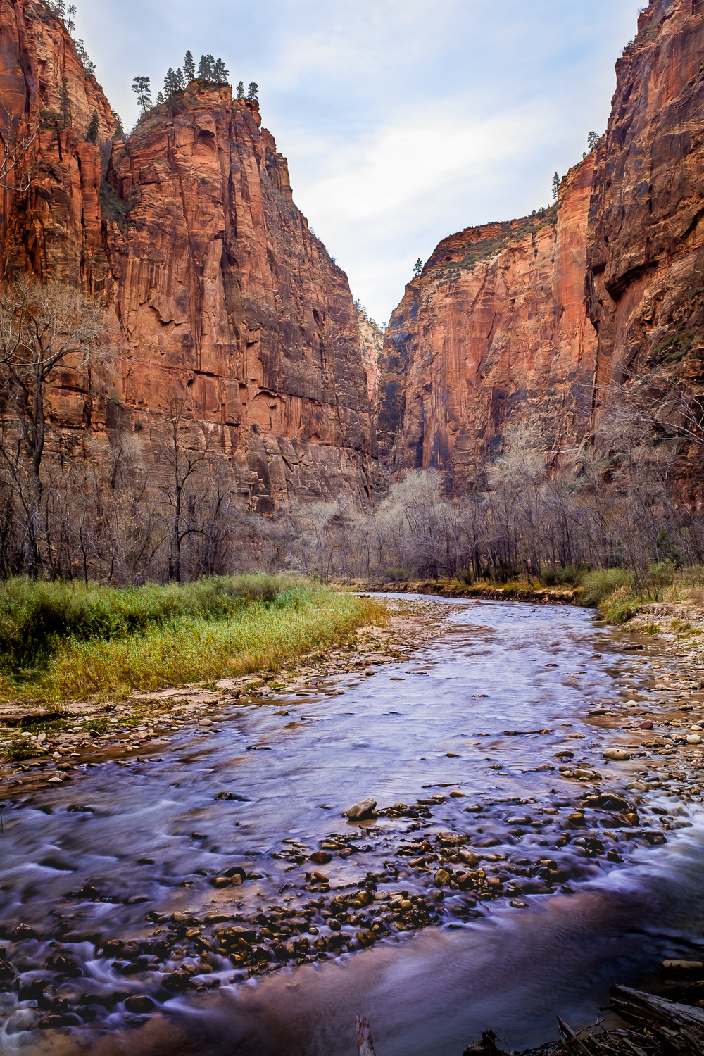 Filtered -   A gravel bar filters water as the Virgin River makes a bend in the Zion Valley. This is the only shot from this post that is not handheld. I mounted the camera to a tiny Ultra Pod II so I could slow the shutter down and capture the river's movement, the X100t's built in ND filter came in handy here.   [ Fujifilm X100t, f/11, 1/200s, ISO 200 ]