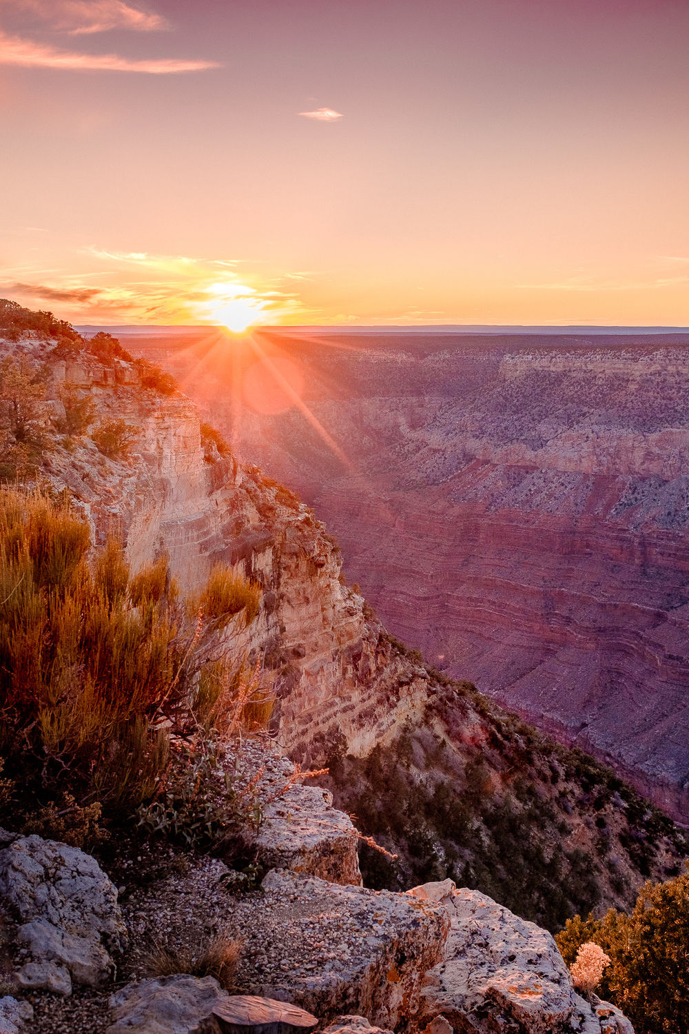 Grand Canyon Sunset -   The sun dips below the Grand Canyon rim, casting a spectacular array of colors. [ Fujifilm X100t, f/5, 1/150s, ISO 200 ]