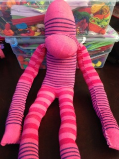 pink sock puppet sewn together
