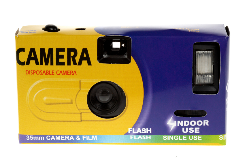 Front view of a cheap disposable camera on a white background