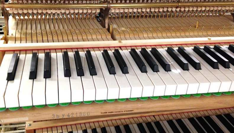 Close up of a piano in progress at the Steinway factory