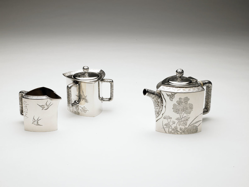 Tiffany & Co. Silver and ivory tea set. Left to right: creamer, sugar bowl, teapot., 1877