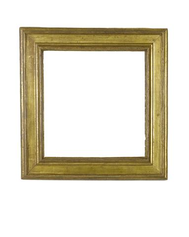 An Italian 16th Century carved and gilded cassetta frame