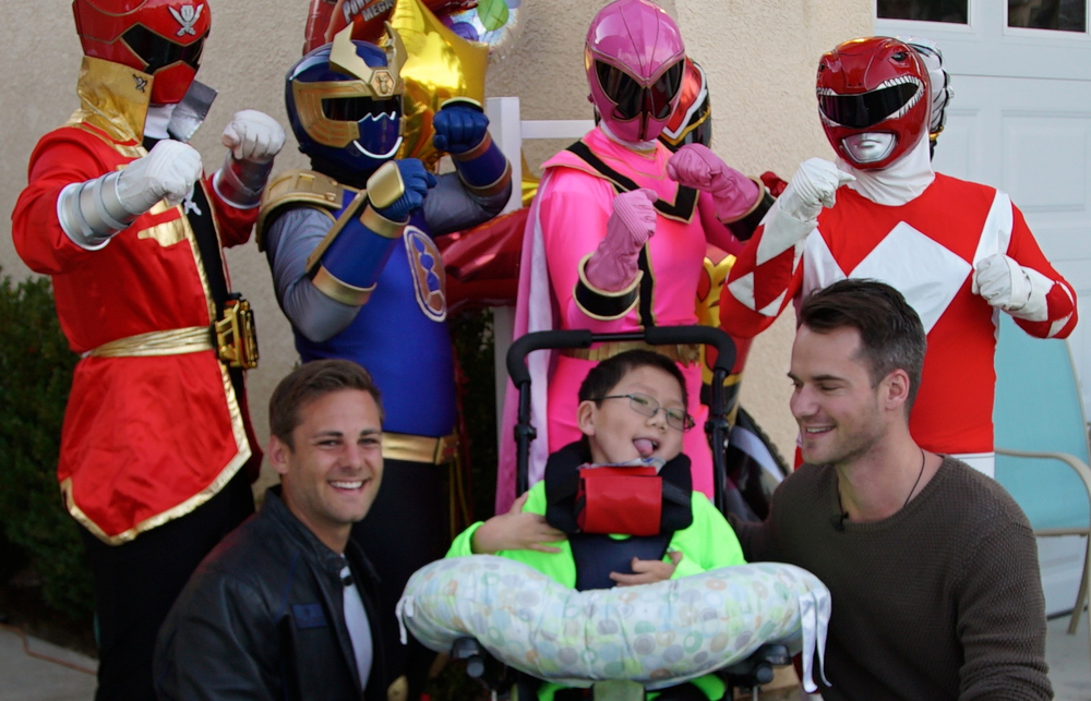 Alex was welcomed home from the hospital by a surprise visit from the Power Rangers