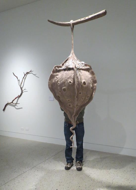 Maxx standing behind one of Pam De Groot's artworks