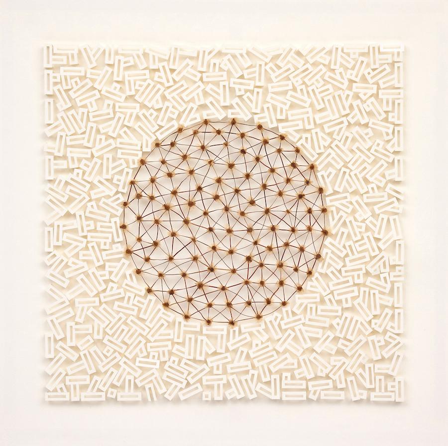 'Embryonic' 2012. 57cm x 57cm. Paper, Pandorea pandorana seeds, Pine needles.