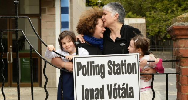 A beautiful 2-Mom family at a polling station before the vote was tallied.