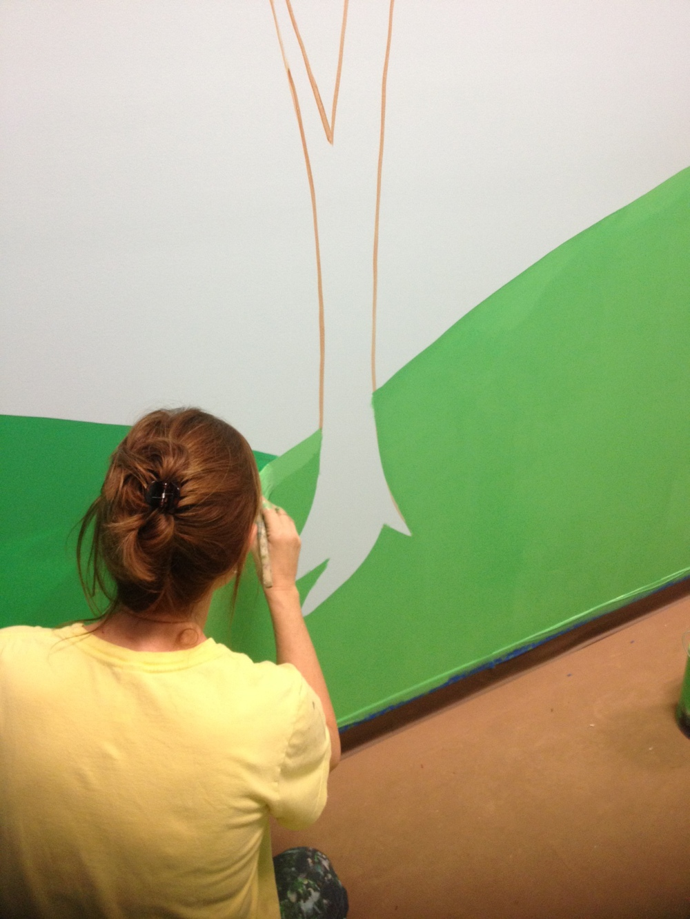 Laura Gross, our fabulous muralist, doing what she does best.