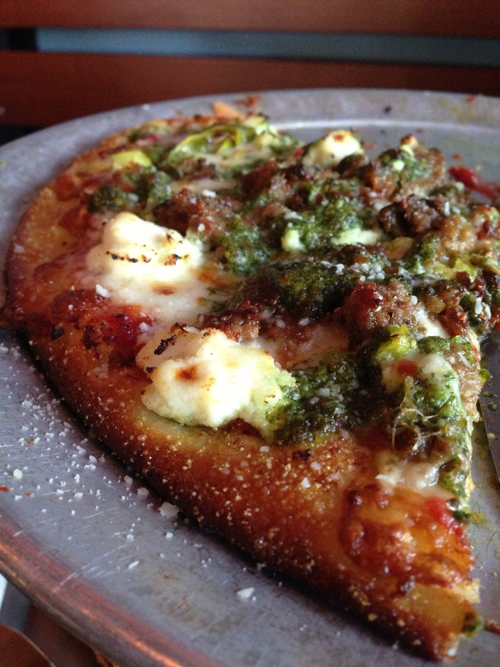 Thin crust variety at Blue Line Pizza adds a crispy, perfectly charred crust.