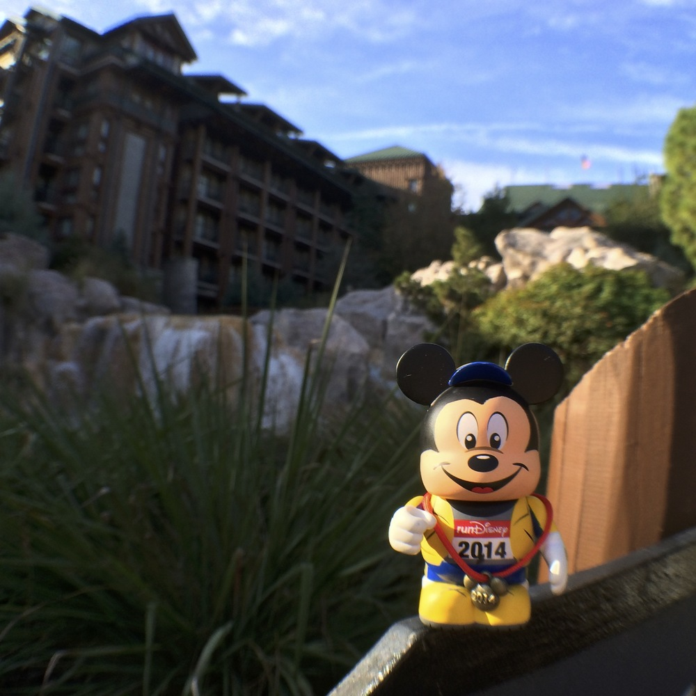 Vinylmation Runner Mickey proudly wears his medal at Disney's Wilderness Lodge. There's lots of exclusive merchandise to collect from runDisney races.