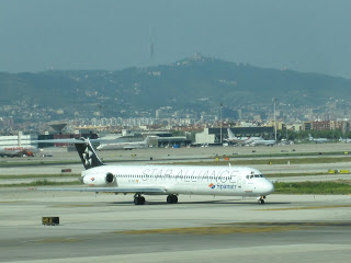 A Spanair MD-83 with the city of Barcelona in the background