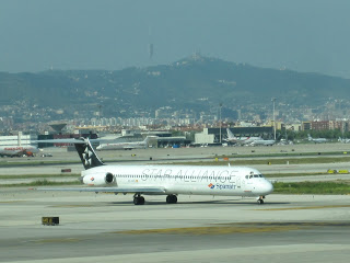 Spanair MD-83 EC-GVO  with the city of Barcelona in the background