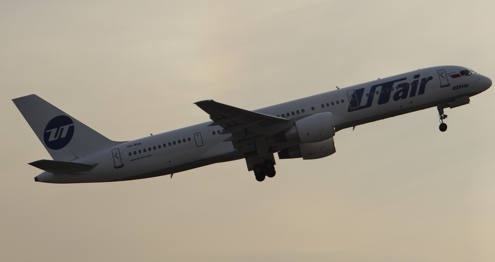 UTair Boeing 757 taking off at sunset