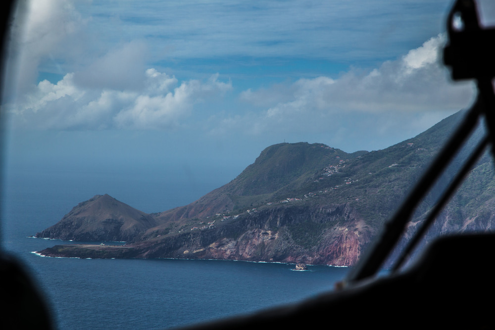 Approach to the island of Saba. In case you were wondering the airport is the tiny flat strip at the bottom left side of the mountain. Picture:  Kristen Kellogg/Border Free Travels