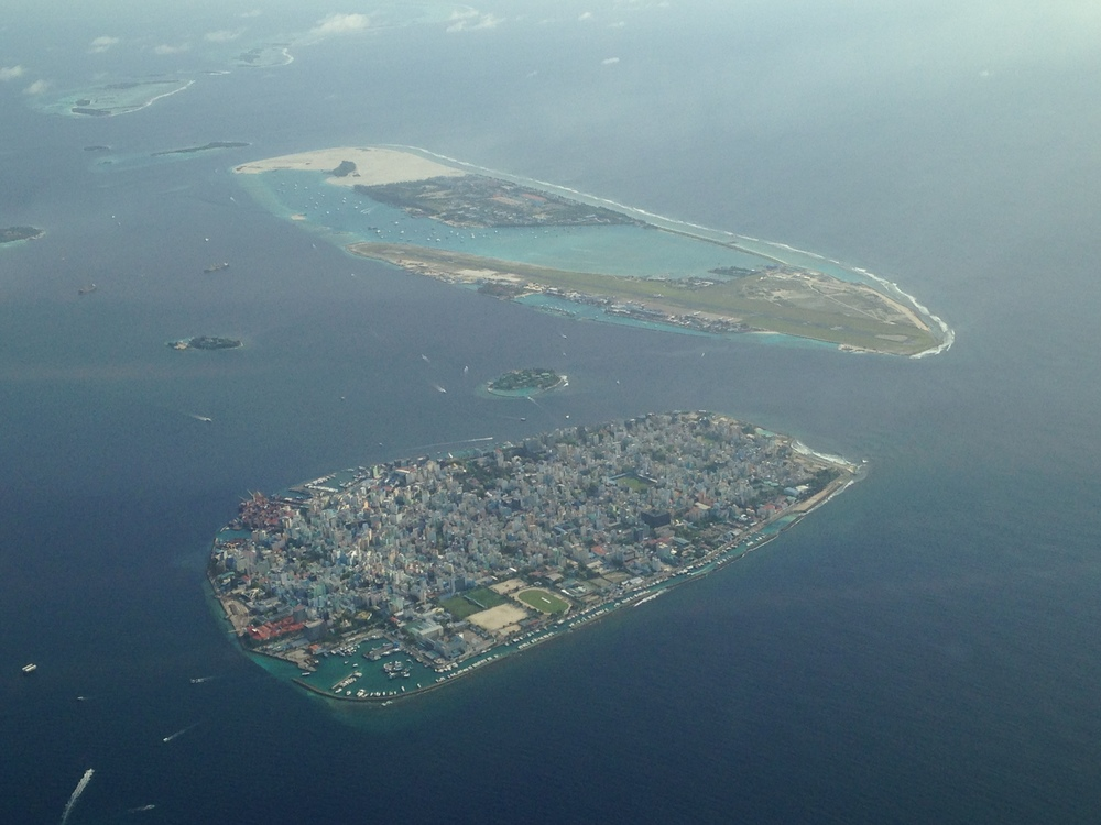 An aerial view of Male and its airport, on the nearby island