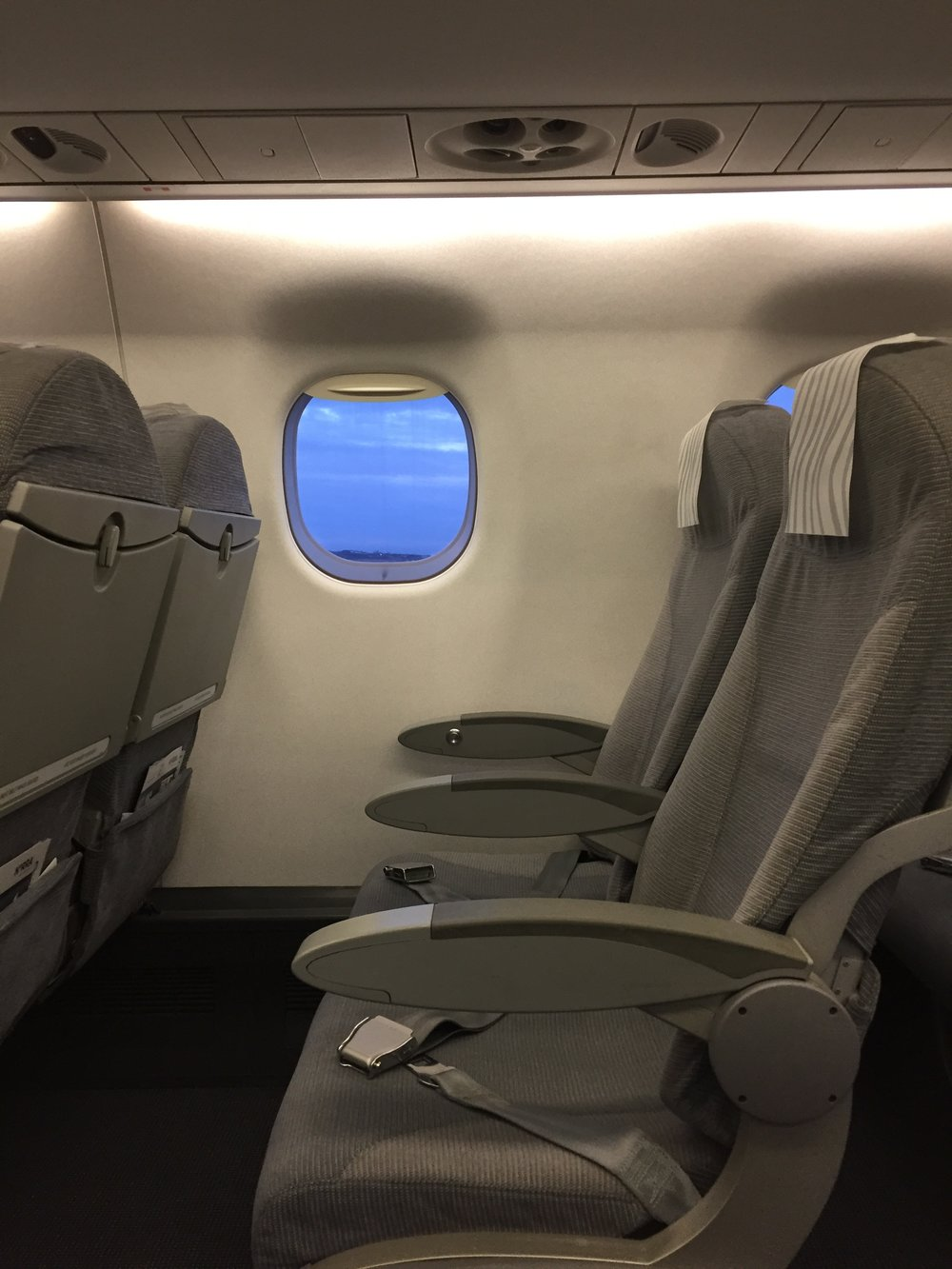The seats are the same as in economy and I think the seat pitch is the same too, the difference is, thus, in the onboard service (for example, upon entry a flight attendant offered to keep my coat in the wardrobe at the front of the cabin), the food and the priority boarding and lounge