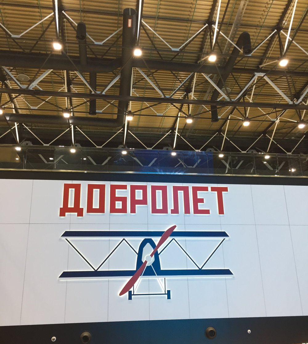 Here a reference to Russian (Soviet to be more exact) commercial aviation pioneering company, Dobrolyot (Добролёт), the antecesor of Aeroflot (interestingly this was also the first name that Aeroflot chose in 2013 for its low cost airline. It has since changed its name to Pobeda, since the original airline was added to the EU sanctions list)