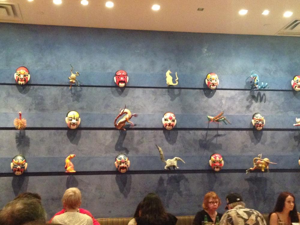 Masks on wall at China Poblano