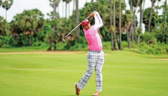 Indian golfer Amish Jaitha hits a shot off the fairway on his way to winning the Angkor Amateur Open at the Angkor Golf Resort in Siem Reap yesterday. Photo Supplied