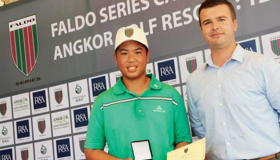 Overall winner Thongpipat Rattanayanon of Thailand receives a medal from David Baron, AGR's director of golf. Photo supplied