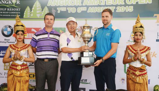 Ly Hong is presented with the trophy after winning the Angkor Amateur Open Golf Championship in Siem Reap yesterday. PHOTO SUPPLIED