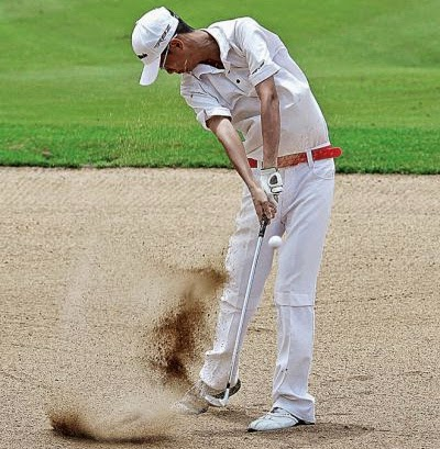 Sim You Wei of Malaysia hits a bunker shot during the Cambodian leg of the 2012 Faldo Series at the Angkor Golf Resort in Siem Reap. Photo:  Sreng Meng Srun