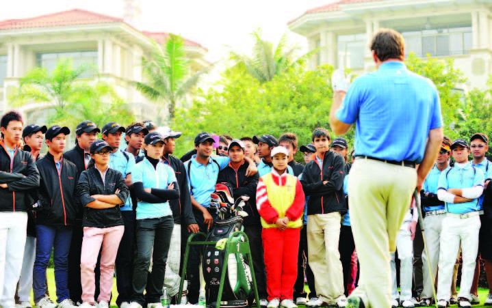 Sir Nick Faldo addresses trainees at a Faldo Series golf clinic.