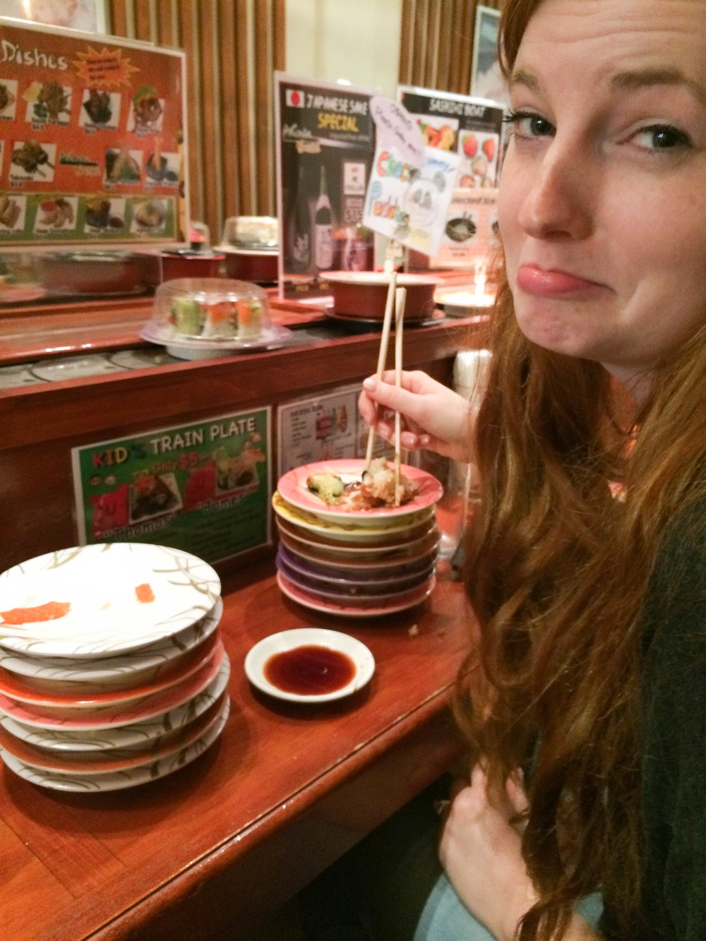 I look sad because I got too much sushi and I couldn't eat it all.
