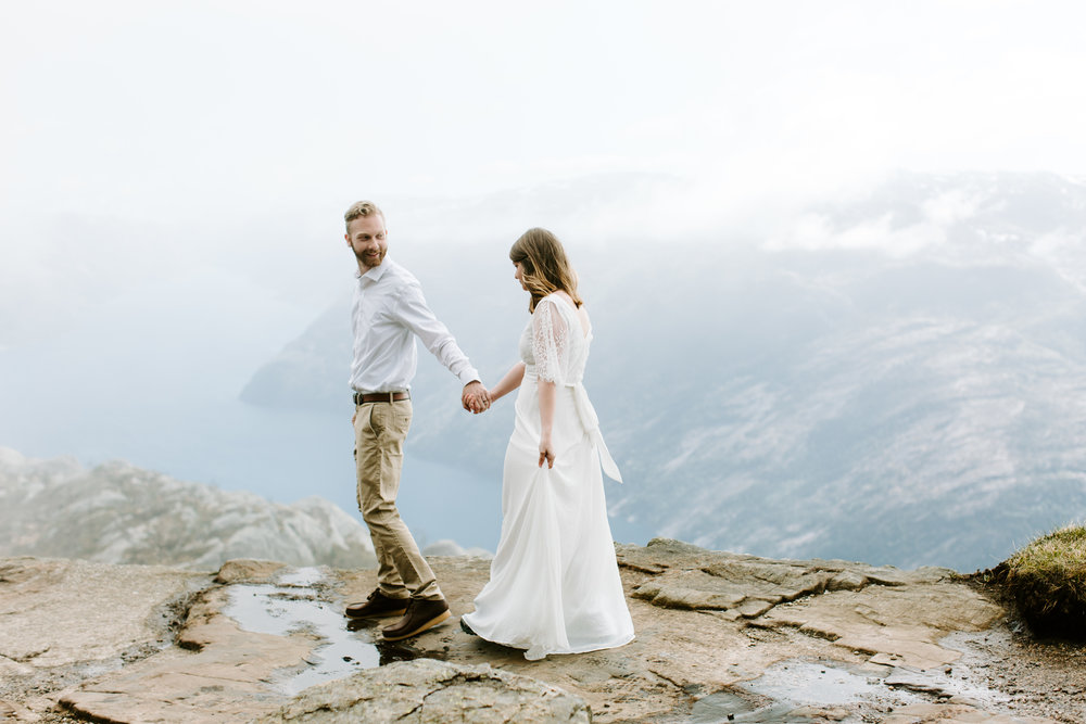 bride and groom on pulpit rock