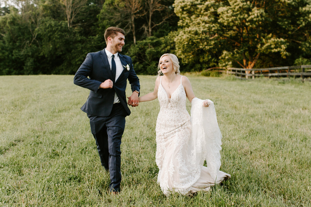 bride-and-groom-running-through-field.jpg