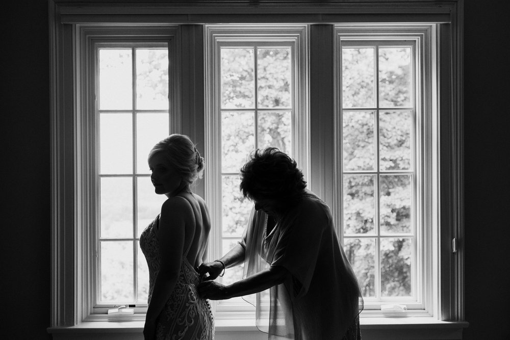 bride-and-mom-getting-into-dress.jpg