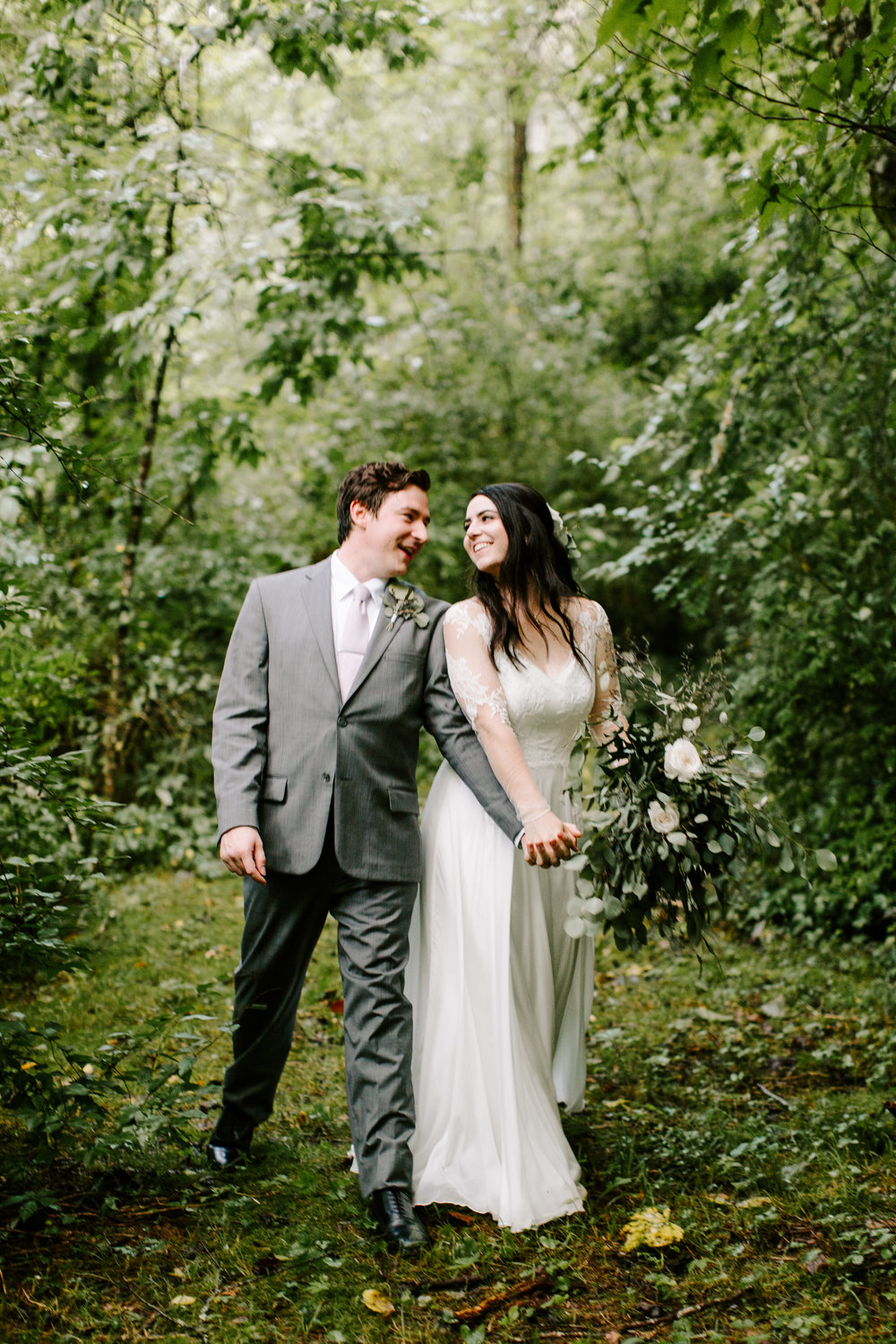 groom-and-bride-holding-hands-in-woods.jpg