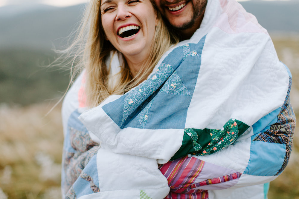 couple wrapped up in quilt