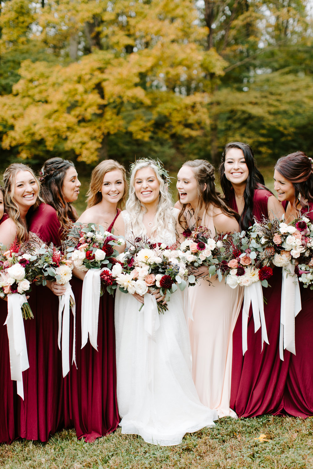laughing bridesmaids in dark red dresses