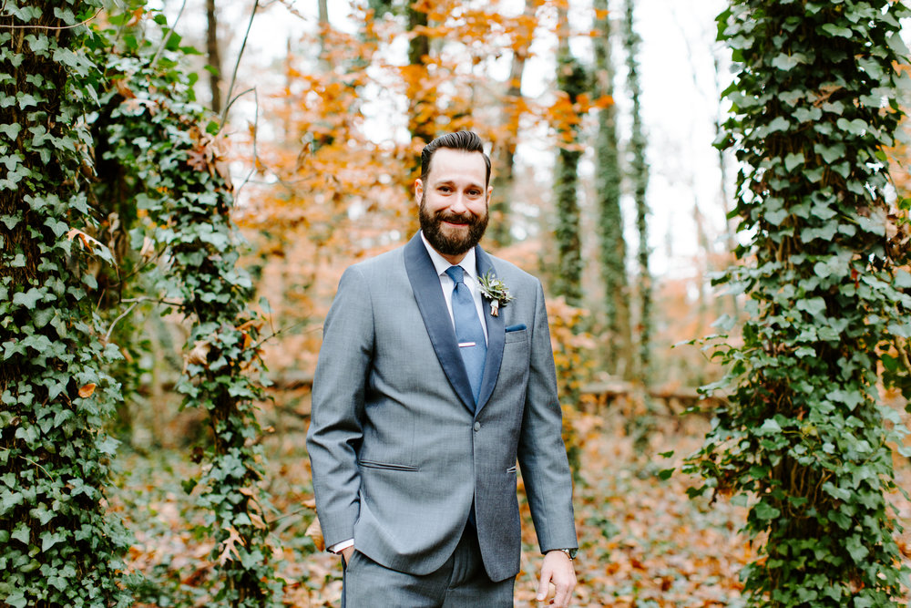 groom with green ivy