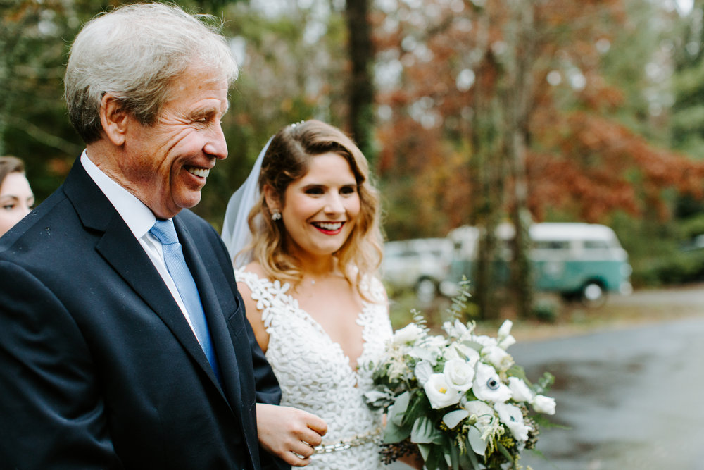 bride and dad right before they walk own the aisle