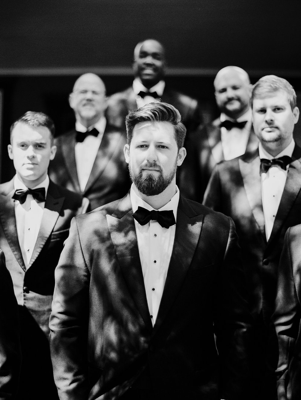black and white groomsmen serious