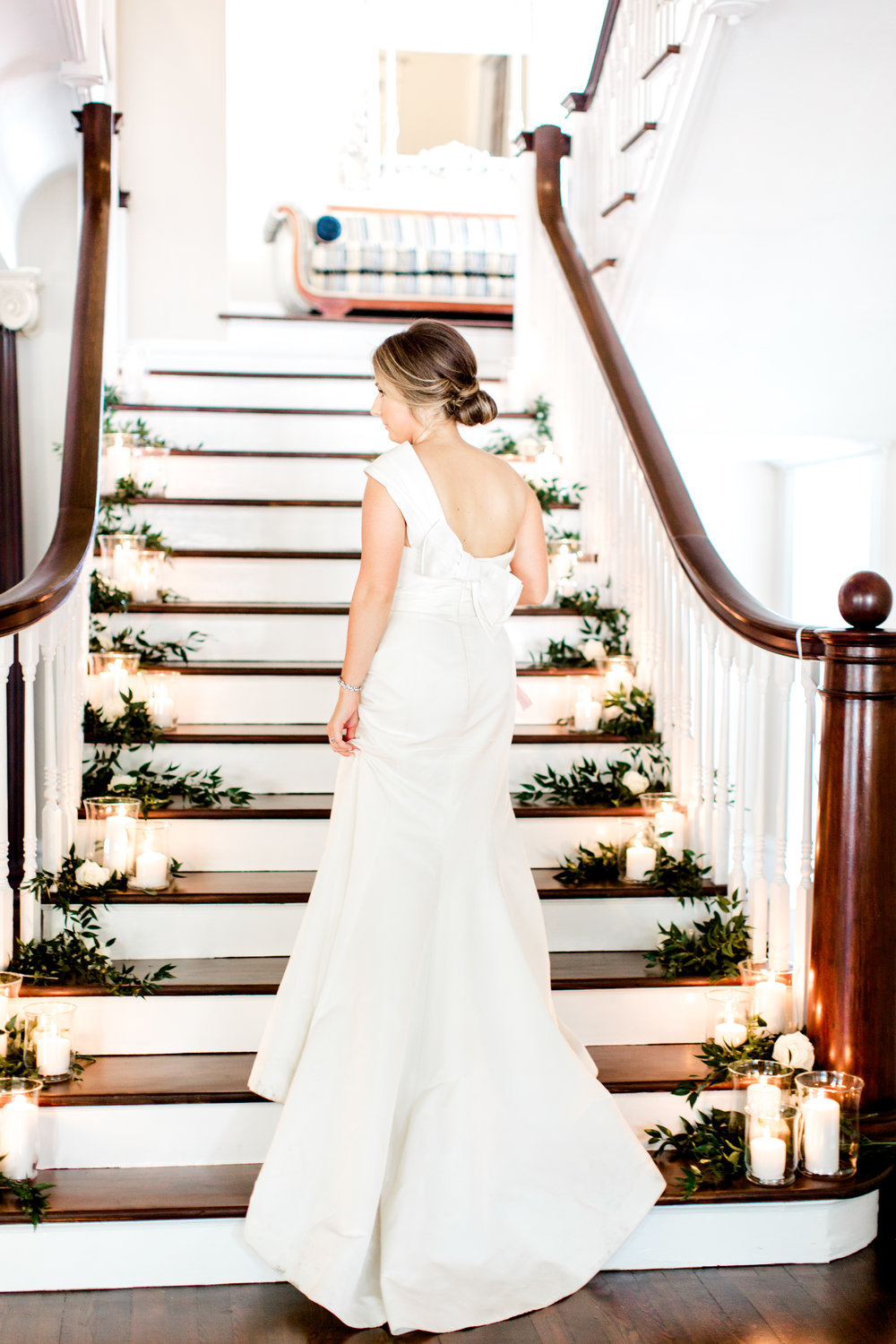 bride walking up candle lit stairs at the orlo