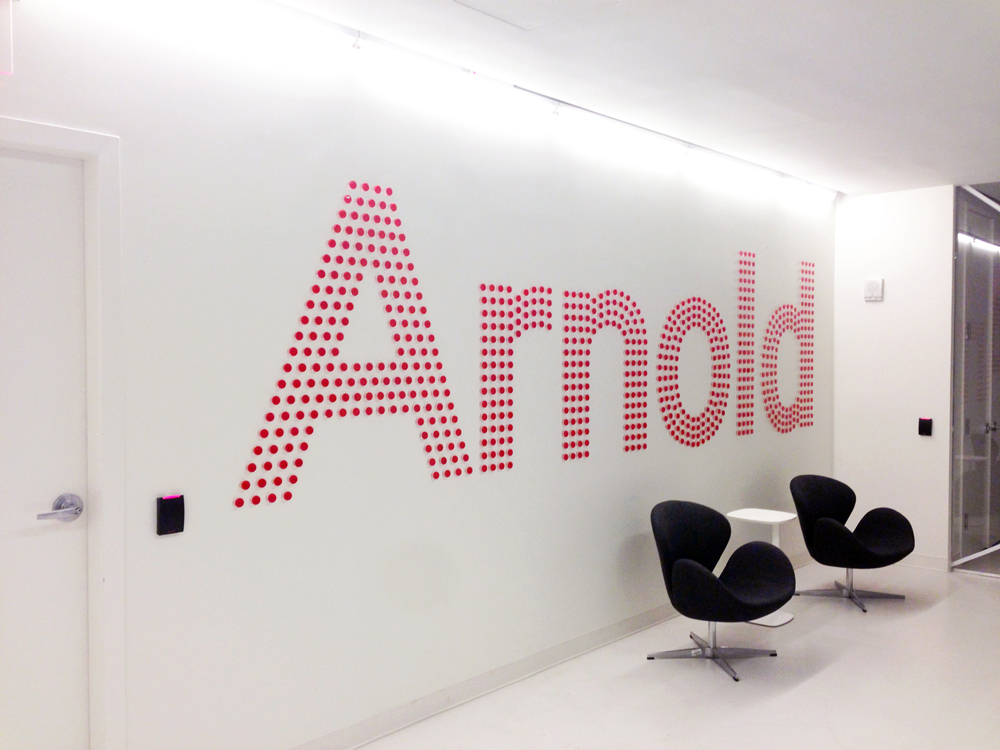 arnold nyc: 205 hudson: bike reflector logo wall