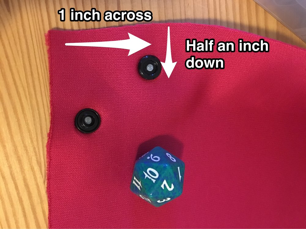 snap placement on collapsible fabric dice tray.