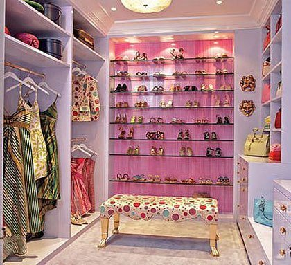 Ladies, all together now....*SIGH*. The lighting is this closet brings life and the illusion of more space. We  love  the recessed lighting above the show shelves! (Photo Credit: eHow)